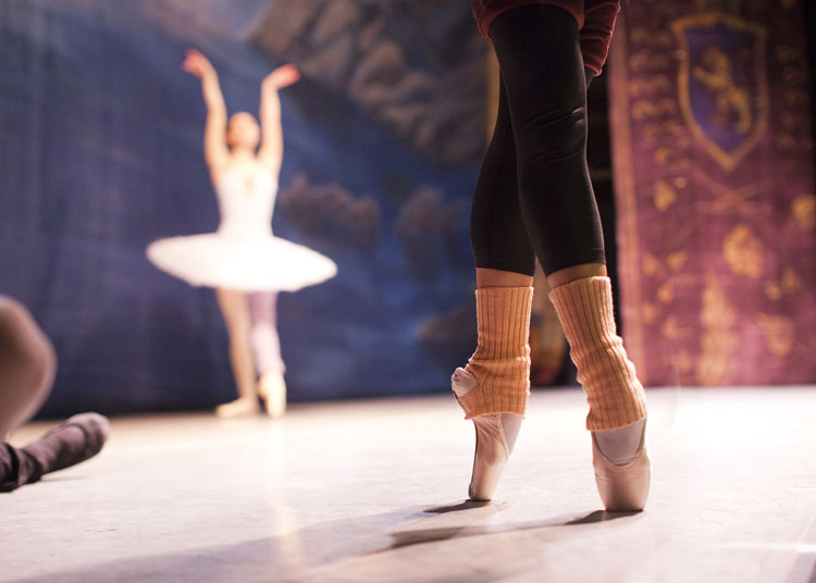 Two ballerinas from the Russian State Ballet of Siberia warming up on stage at The Colosseum in Watford