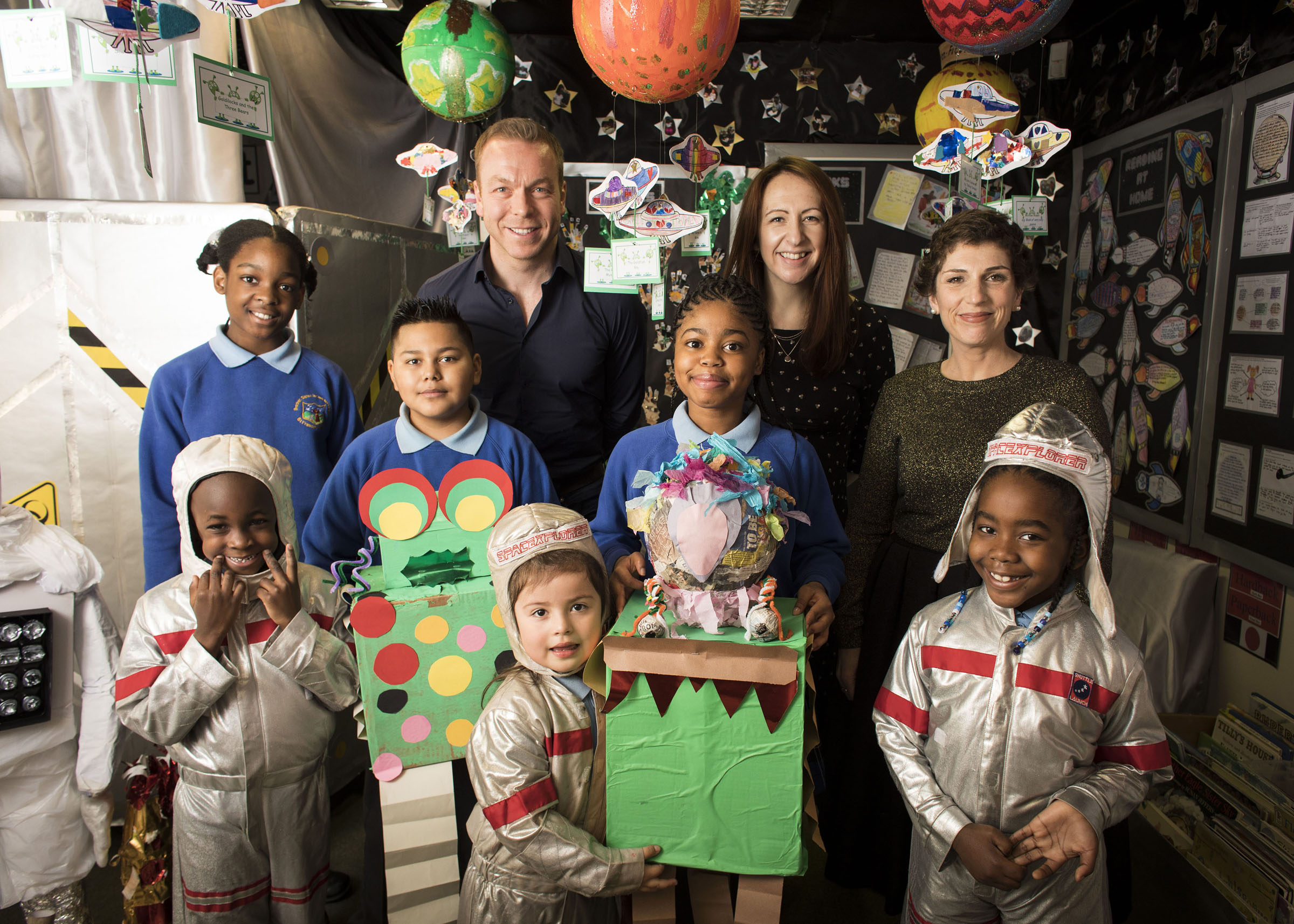 Chris Hoy, Joanna Nadin and Clare Elsom and children from St Francis RC Primary School