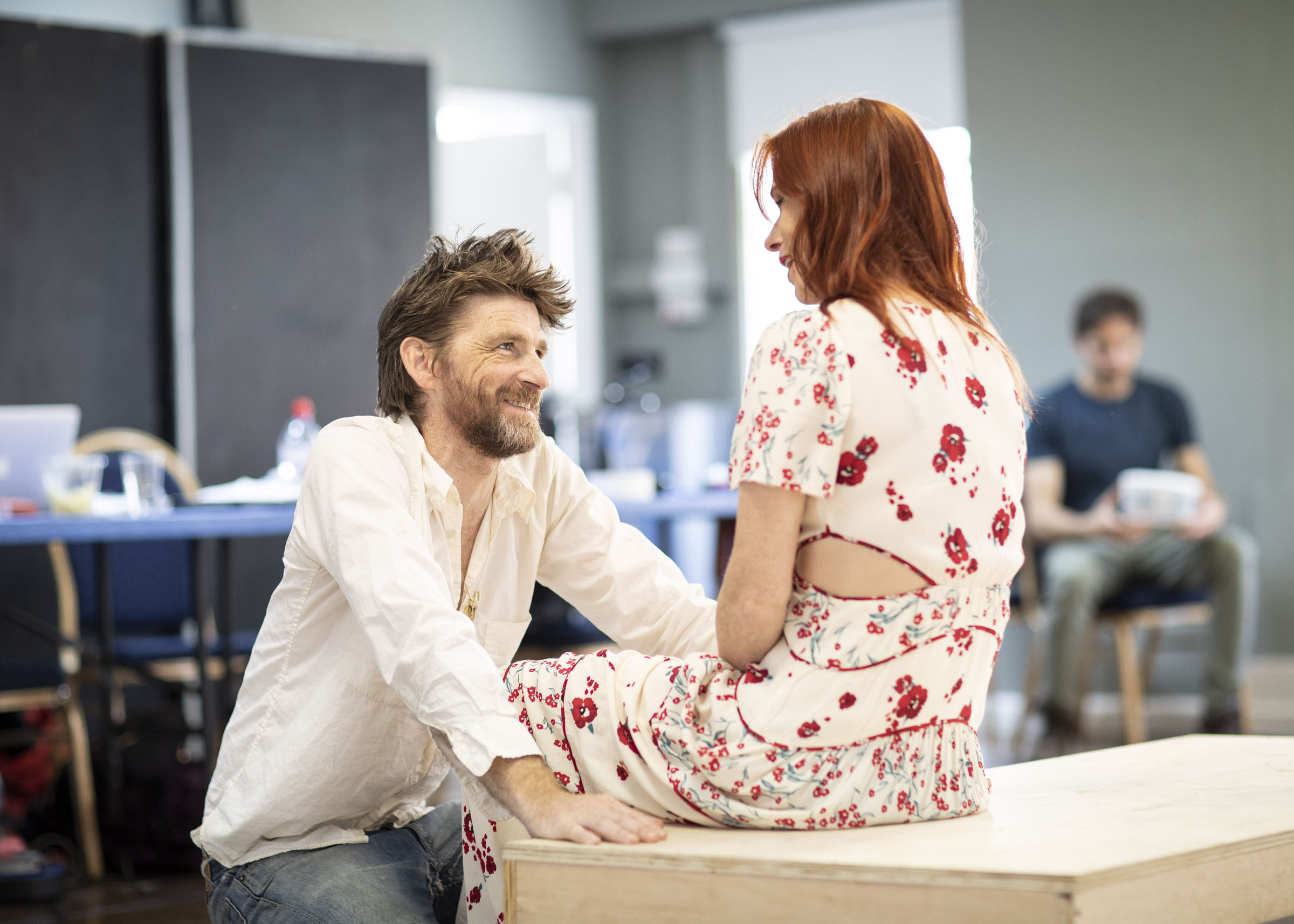 Paul Anderson and Audrey Fleurot laughing during Tartuffe rehearsals
