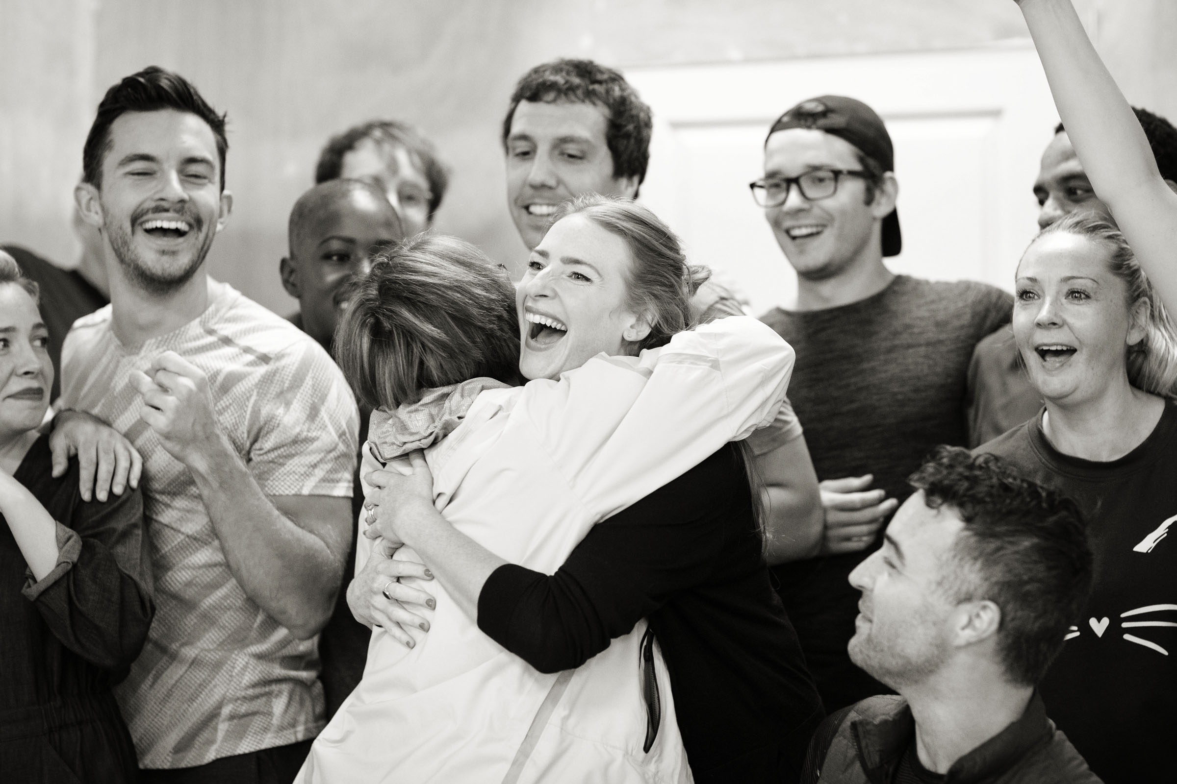 Patti LuPone hugs Rosalie Craig with the cast of Company around them