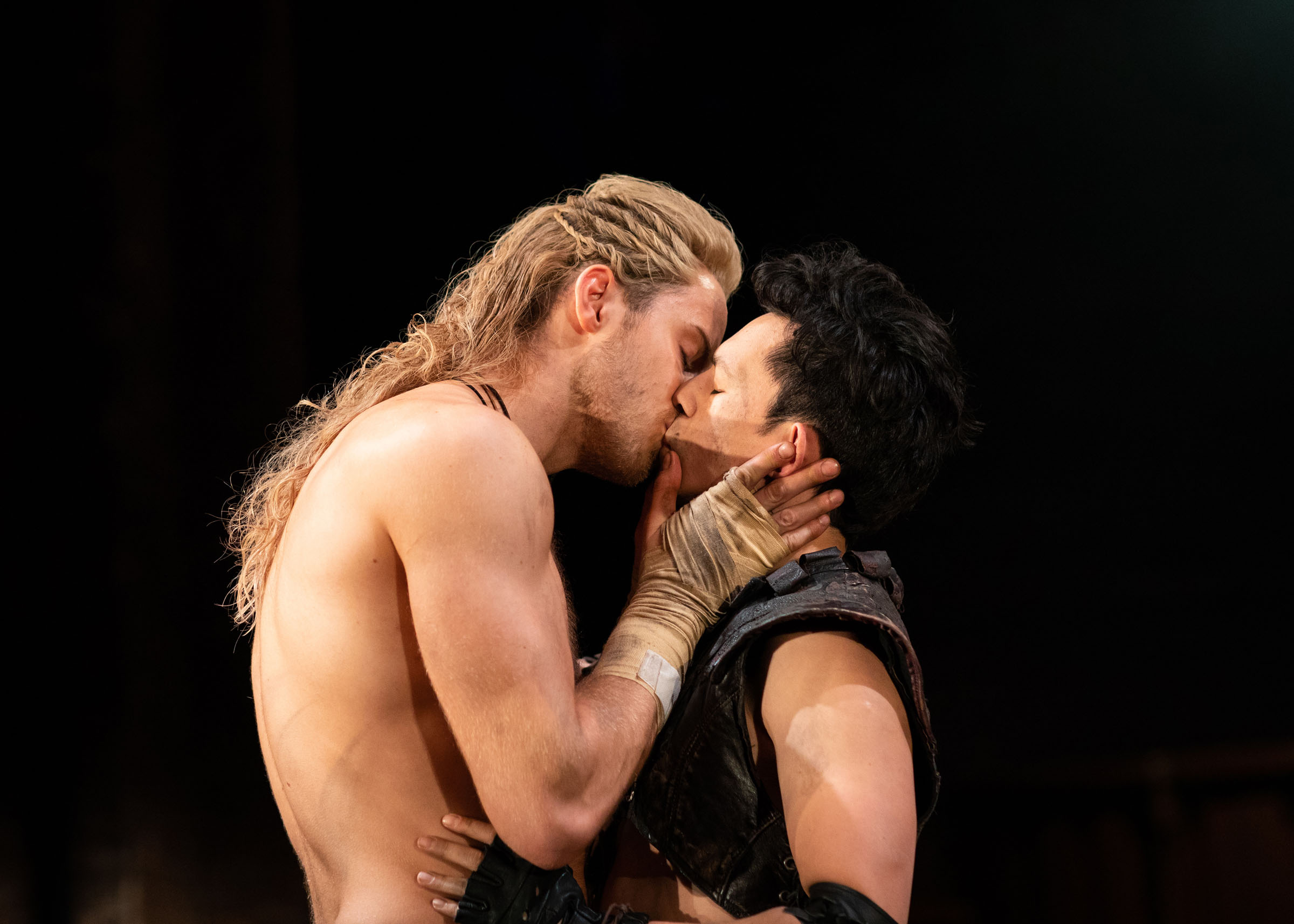 Andy Apollo (Achilles) kisses James Cooney (Patroclus) at the RSC