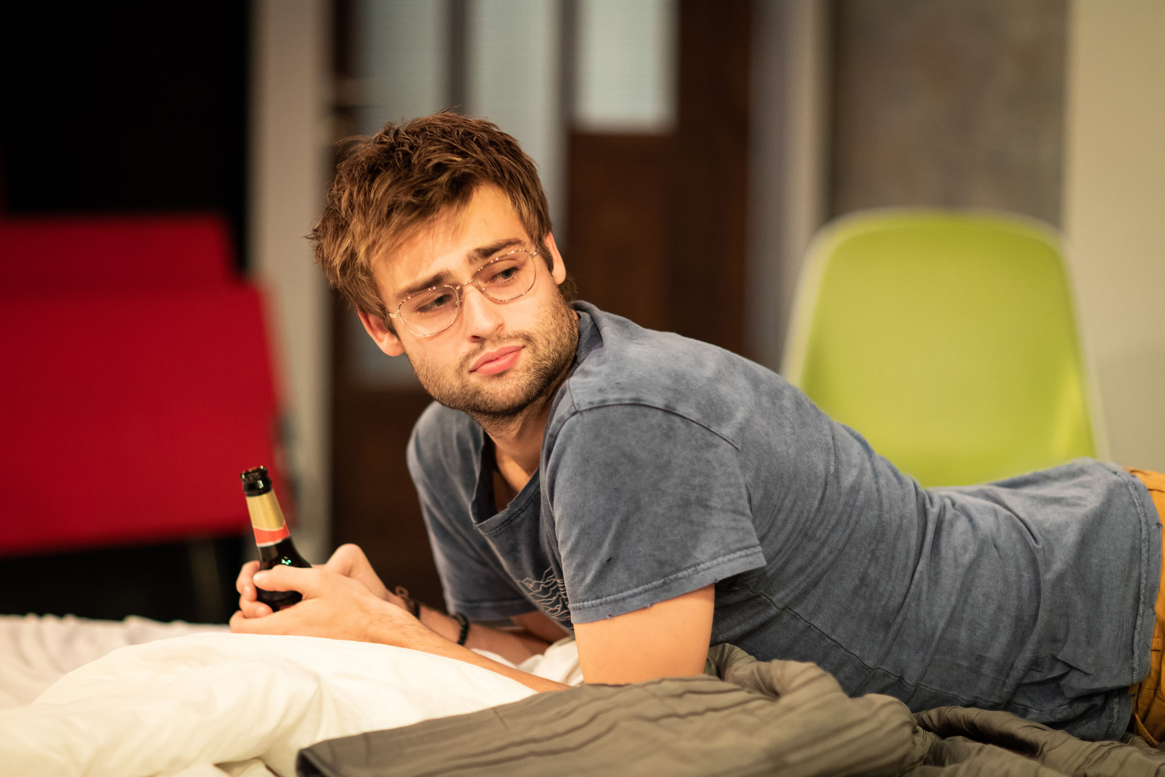 Douglas Booth (Jeremy) with a bottle of beer in 'A Guide for the Homesick'