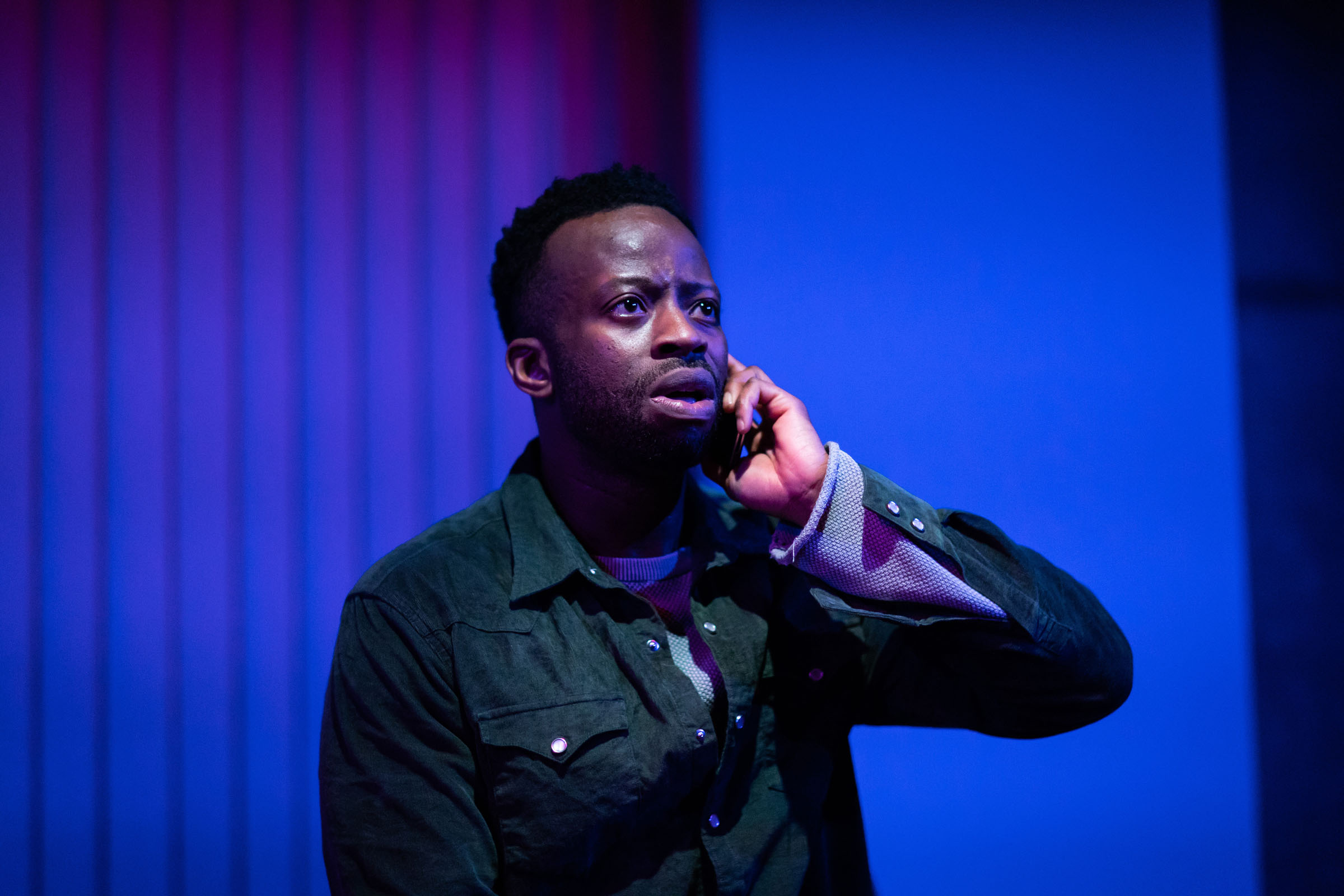 Clifford Samuel (Teddy) speaks on the phone in 'A Guide for the Homesick'