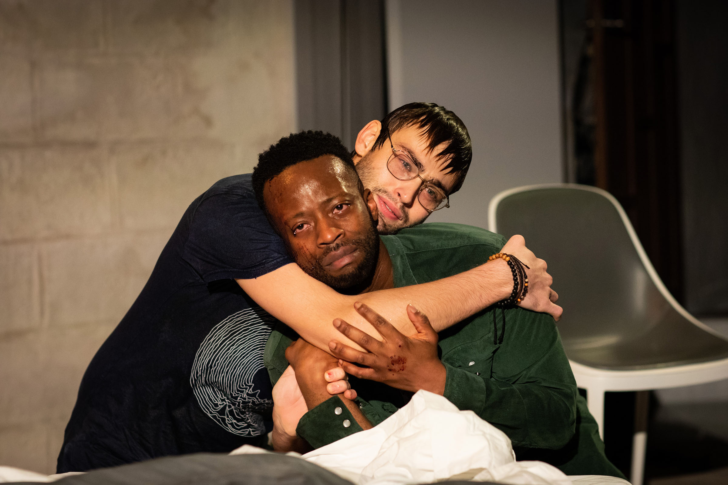 Douglas Booth (Jeremy) and Clifford Samuel (Teddy) hold each other in 'A Guide for the Homesick'