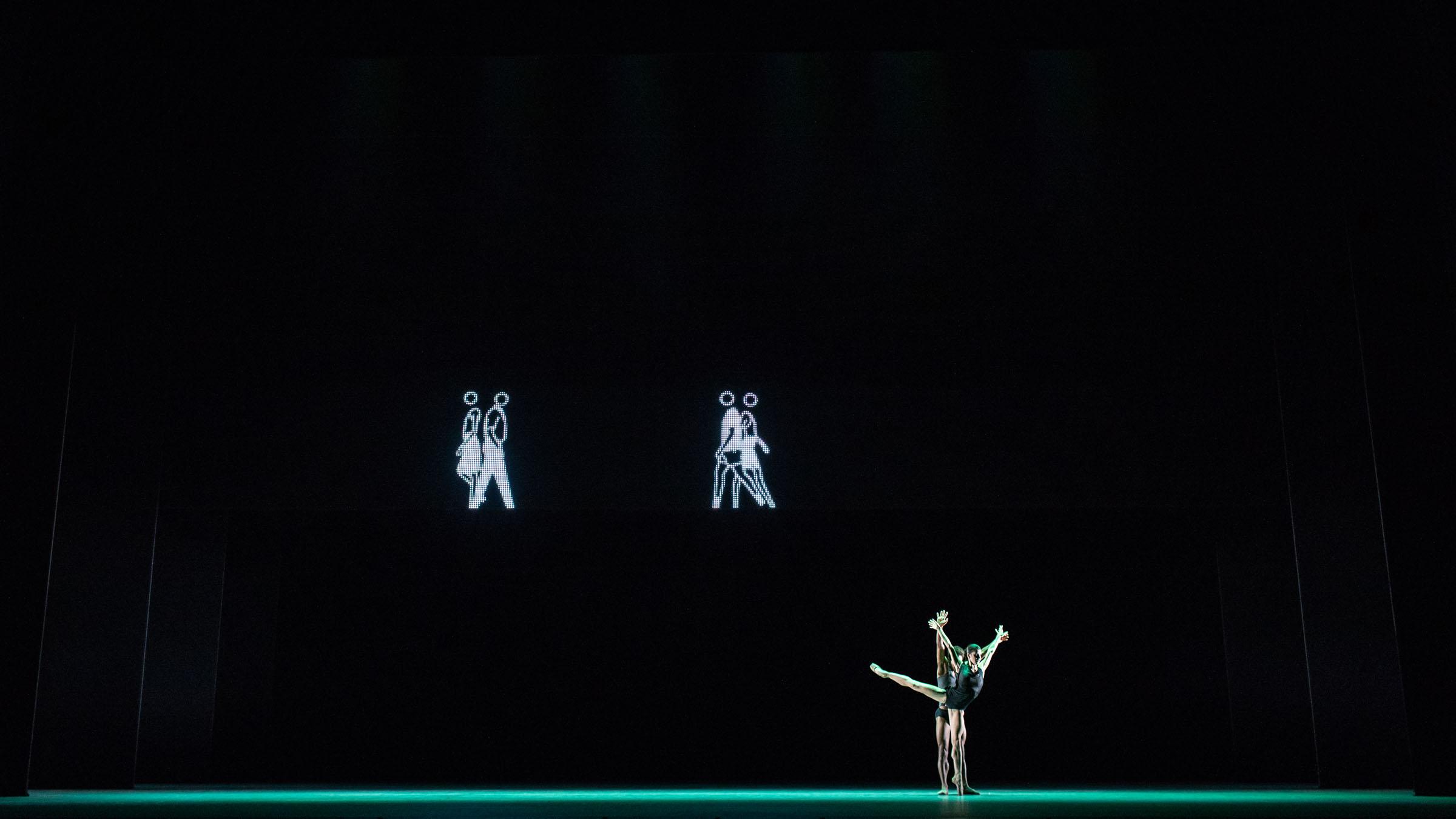 Mayara Magri and Marcelino Sambé in Infra with Julian Opie's artwork
