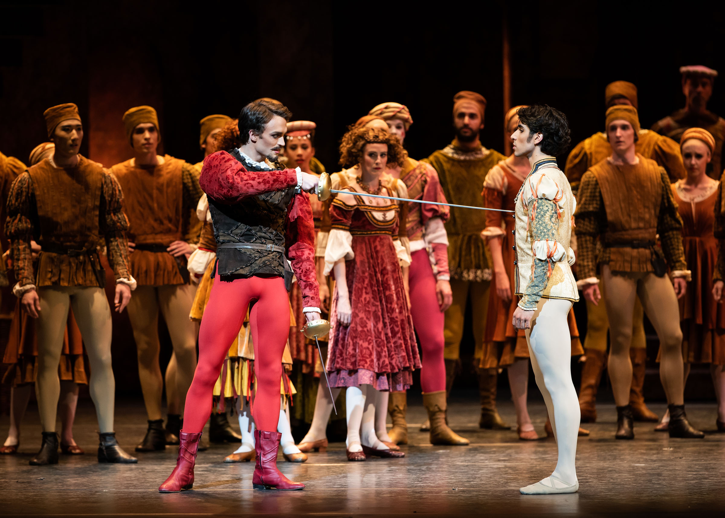Matthew Ball as Tybalt and Cesar Corrales as Romeo