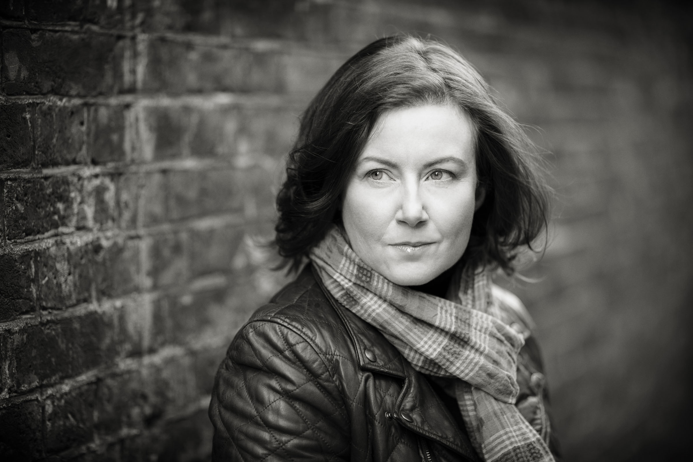A black and white photograph of the author Valentina Giambanco, by Helen Maybanks