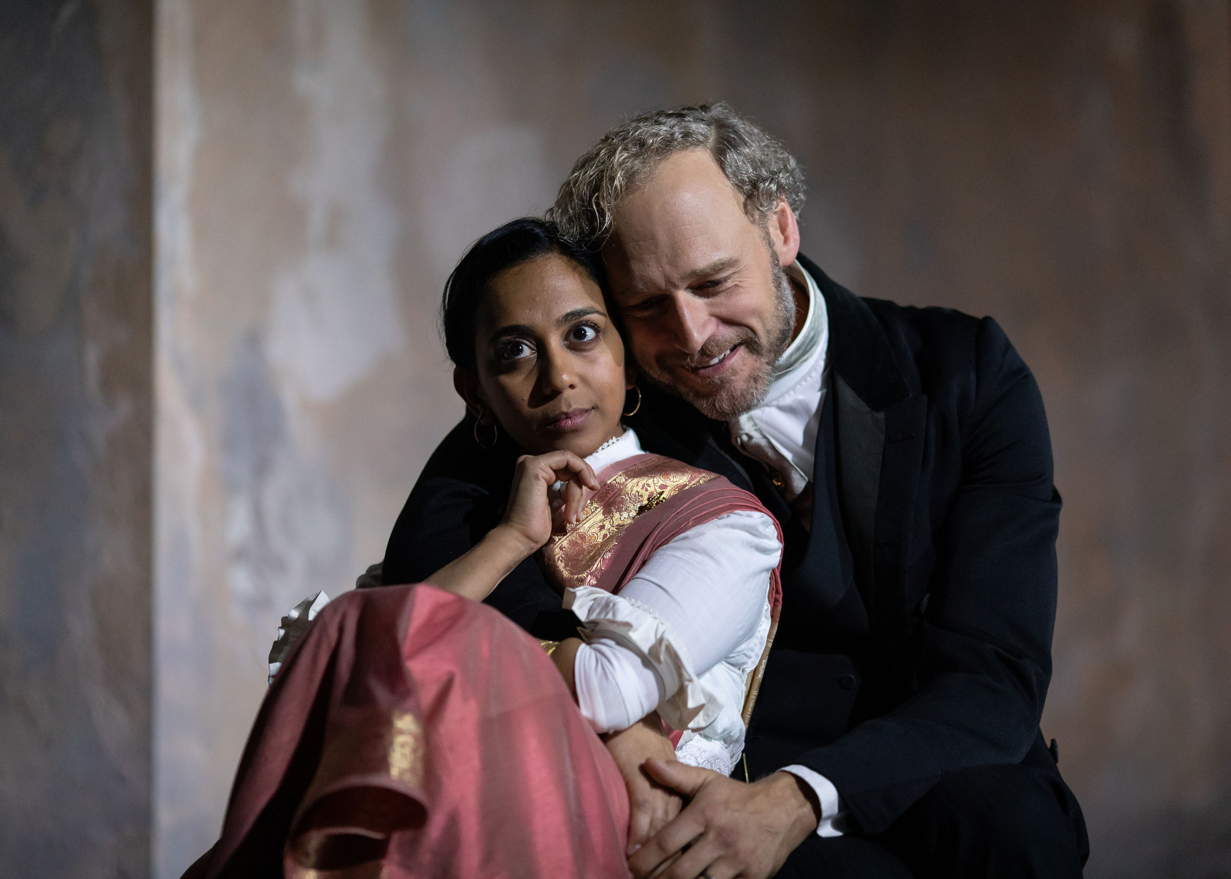 Anjana Vasan as Niru and Elliot Cowan as Tom Helmer