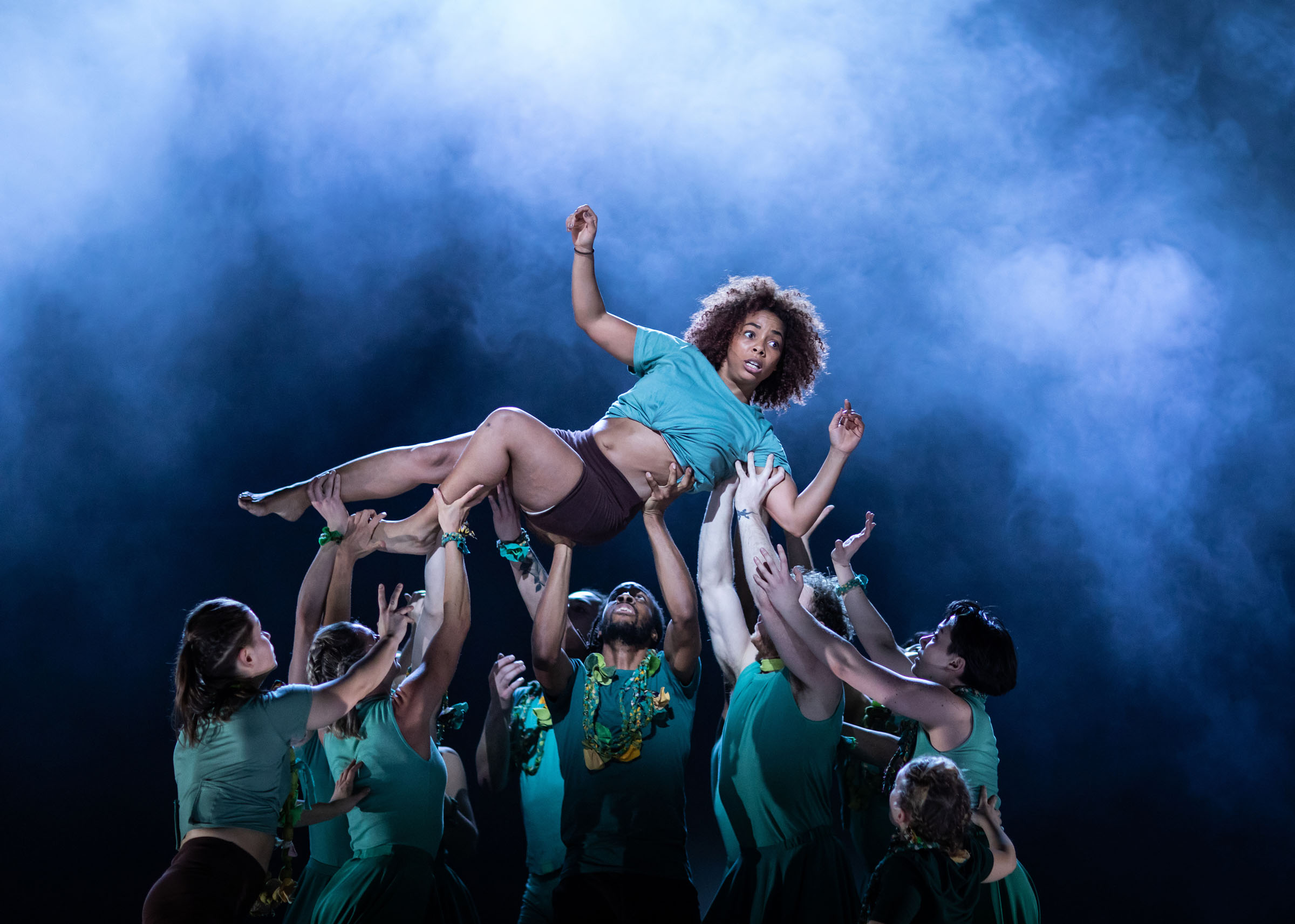 Natasha Gooden is held aloft by the cast of 'Message in a Bottle'